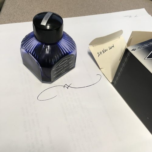 "Bottle of fountain pen ink beside its box with ""24 Nov 2014"" written inside the top flap"