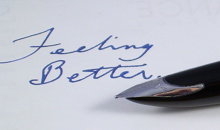 An apparently good-as-new pen, in front of a hand-written message reading FEELING BETTER